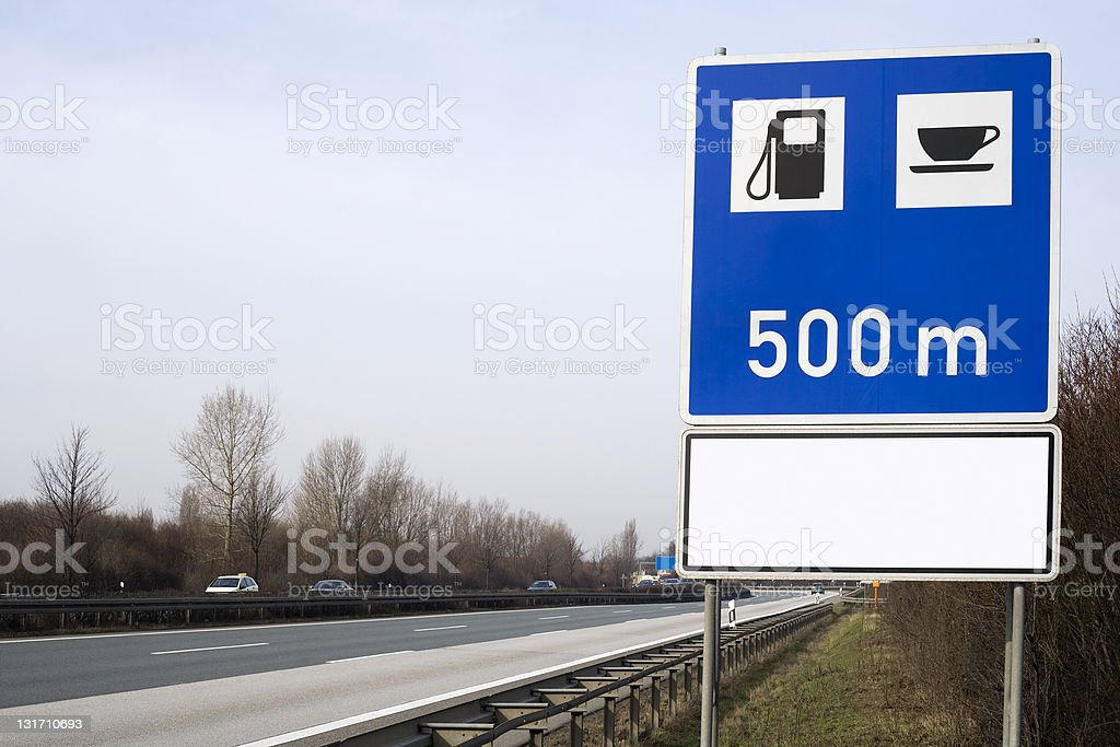 Road sign at the highway - petrol station royalty-free stock photo