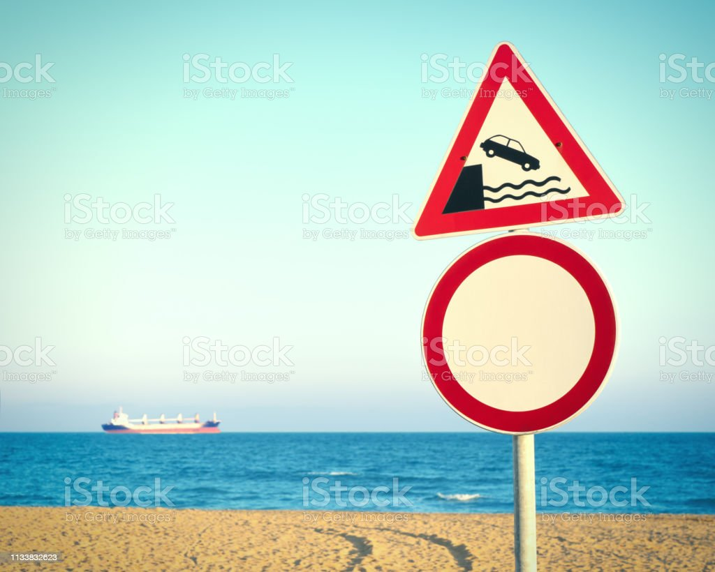 Road sign. Attention, open! A sign on a background of blue sea and...