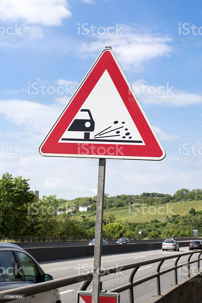 Road sign - danger, dirty roadway