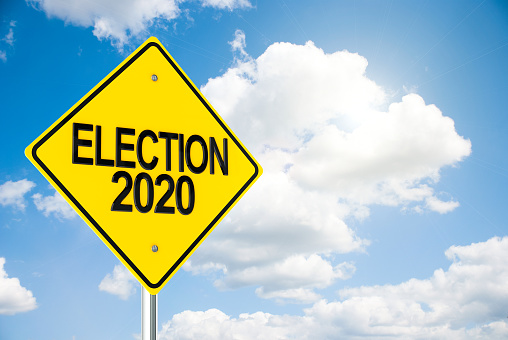 istock Road sign Election 2020 on sky 1181740254
