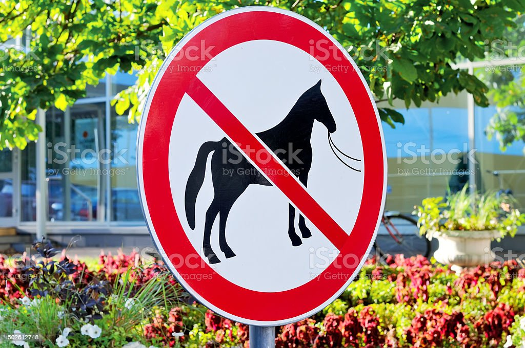 Road sign forbidding a parking of horses stock photo