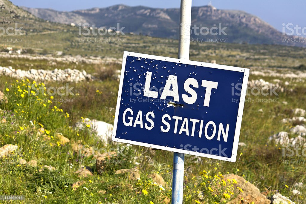 Road sign full of shotgun holes stock photo