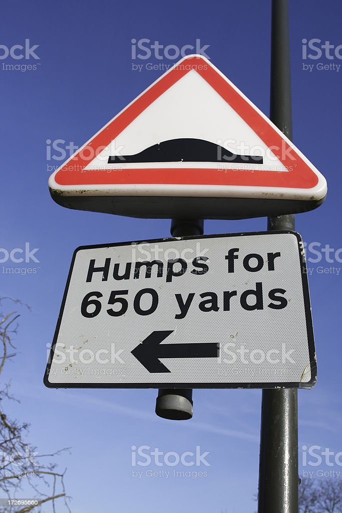 Road sign humps signal bumpy ride royalty-free stock photo