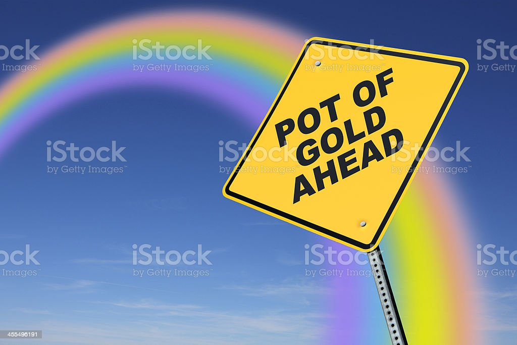 Road sign indicating 'Pot of Gold' at end of rainbow royalty-free stock photo