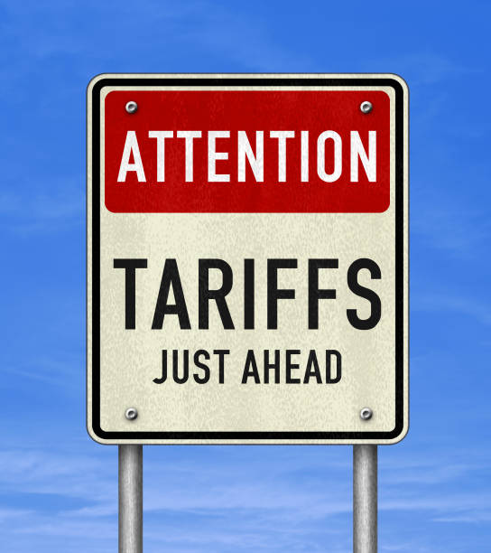 Road sign message - Tariffs just ahead Road sign message - Tariffs just ahead tariff stock pictures, royalty-free photos & images