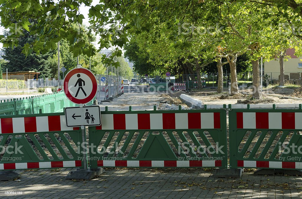 Road sign - no trepassing. Pedestrians go this way royalty-free stock photo