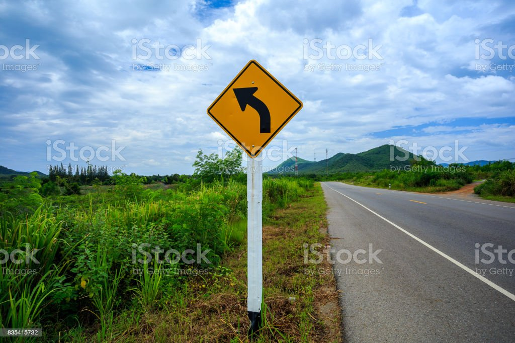 Road sign on a blue sky stock photo