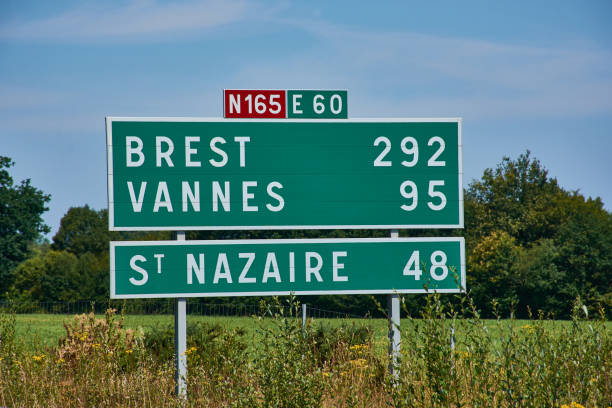 road sign on a French highway with distances stock photo
