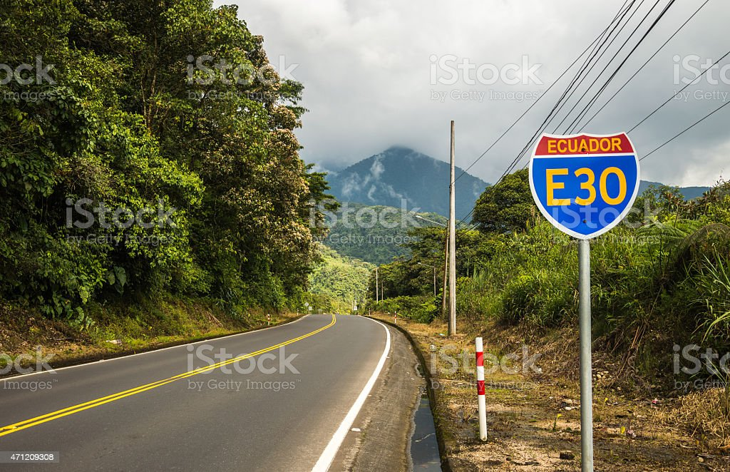Road sign on an empty road in Ecuador. stock photo