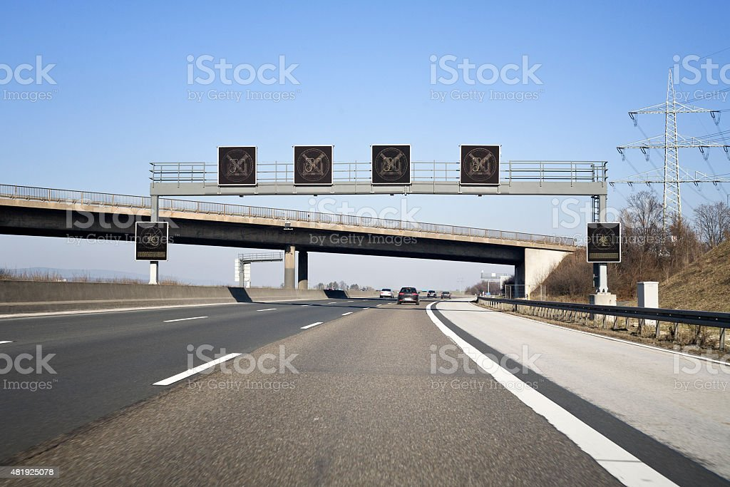 Road sign on german autobahn A5 - traffic information system stock photo