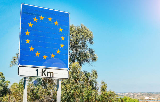 Road sign on the border as part of an European Union member state stock photo