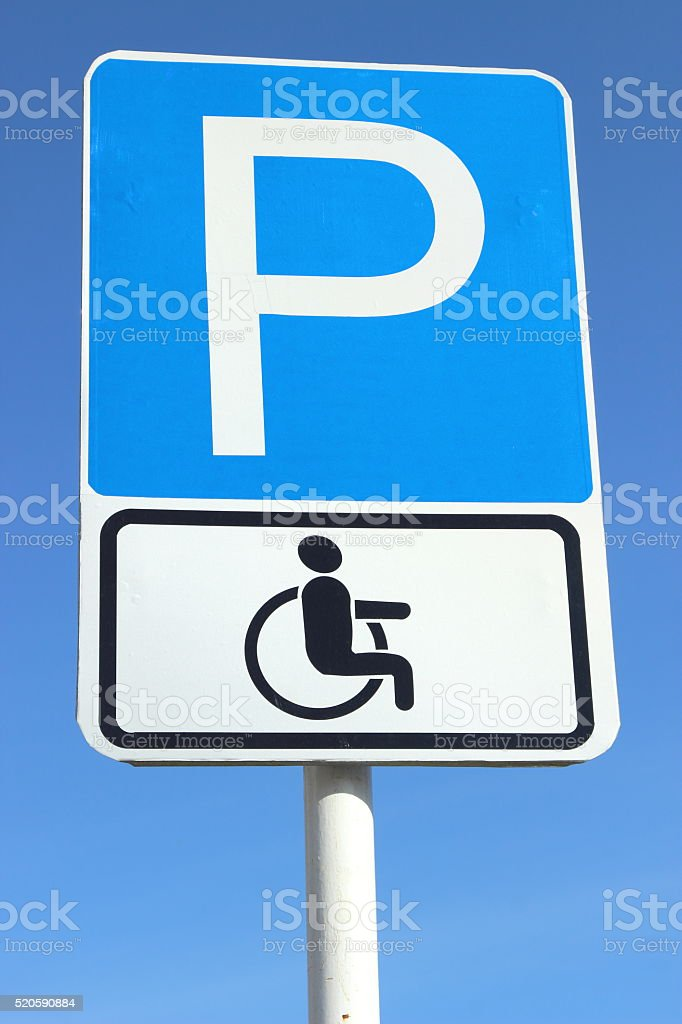 road sign Parking for disabled people in the sky stock photo