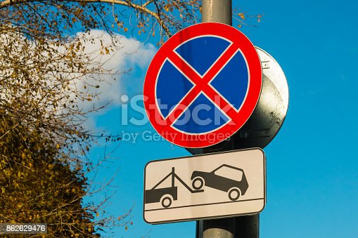istock road sign Parking prohibited and vehicle evacuation 862629476