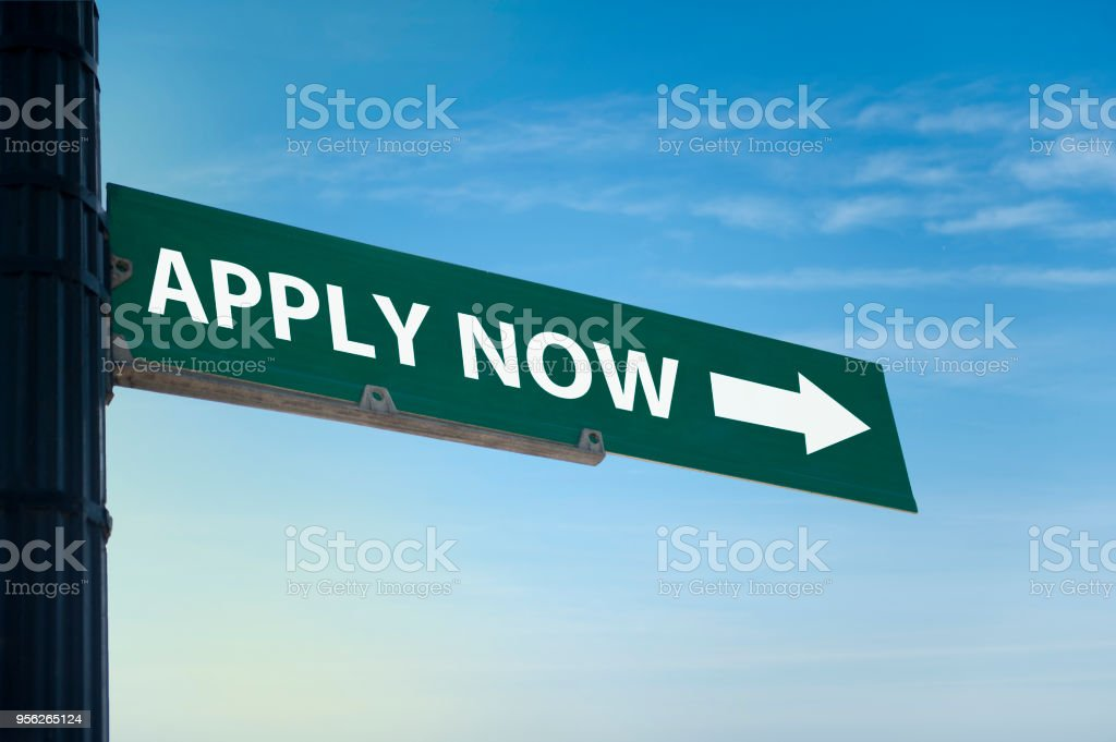 APPLY NOW / Road sign (Click for more) stock photo
