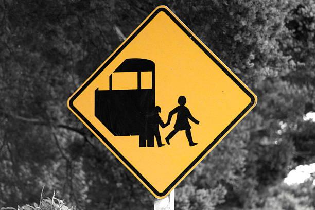 Road sign school bus in New Zealand stock photo