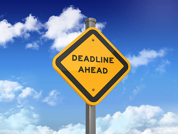 Road Sign Series - DEADLINE AHEAD DEADLINE AHEAD Road Sign on Blue Sky and Clouds Background approaching stock pictures, royalty-free photos & images
