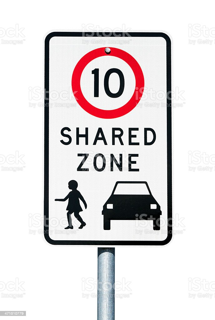 Road sign 'SHARED ZONE' with 10km speed limit, white background royalty-free stock photo