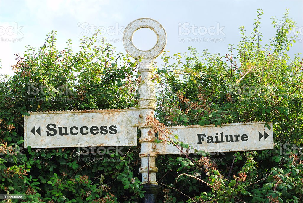 Road sign showing directions of success and failure stock photo