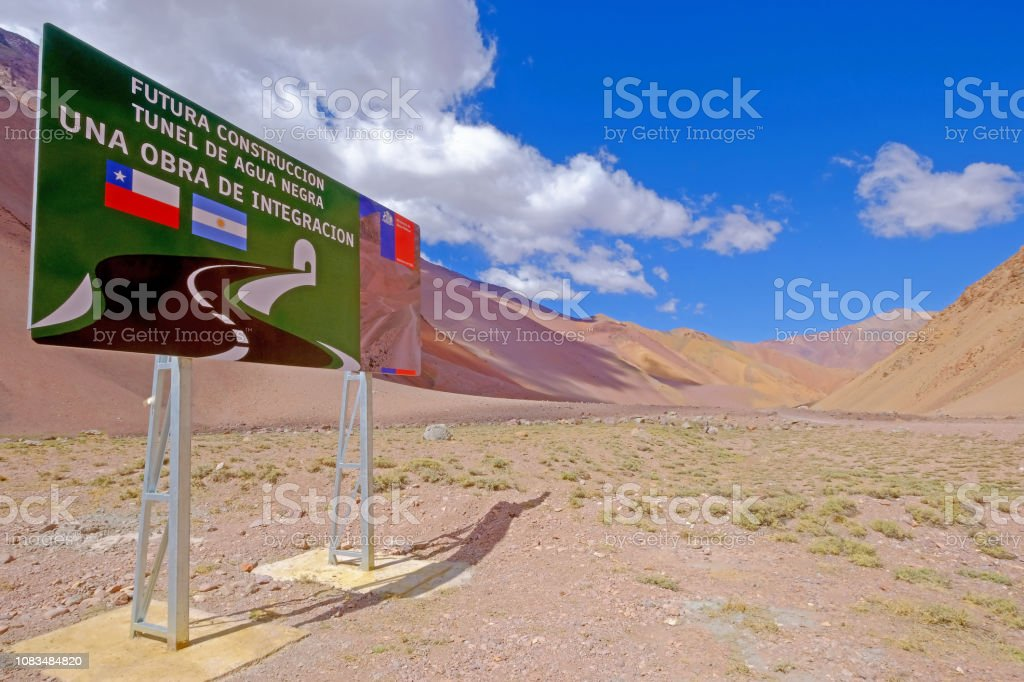 Road sign showing the Agua Negra Tunnel project through the Agua Negra Mountain, from Chile to Argentina, South America stock photo