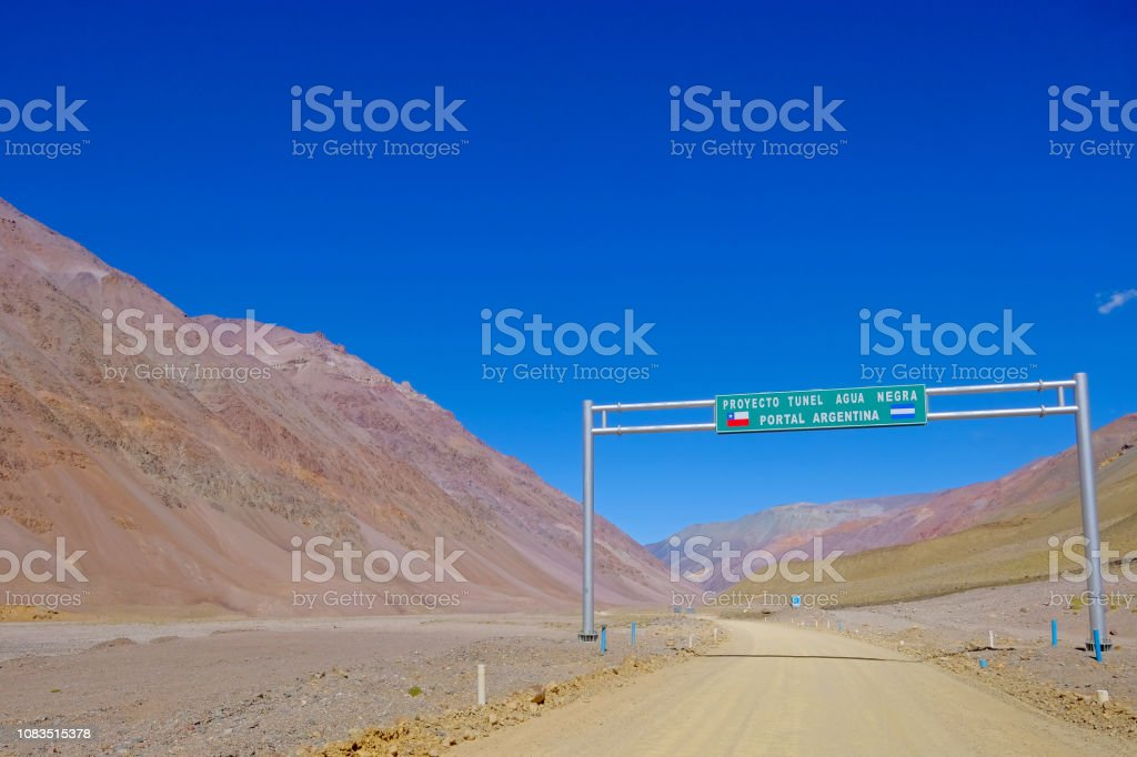 Road sign showing the Agua Negra Tunnel project through the Agua Negra Mountain, from Argentina to Chile, South America stock photo