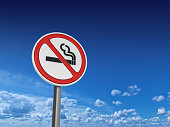 NO SMOKING Road Sign - Sky Background - 3D Rendering