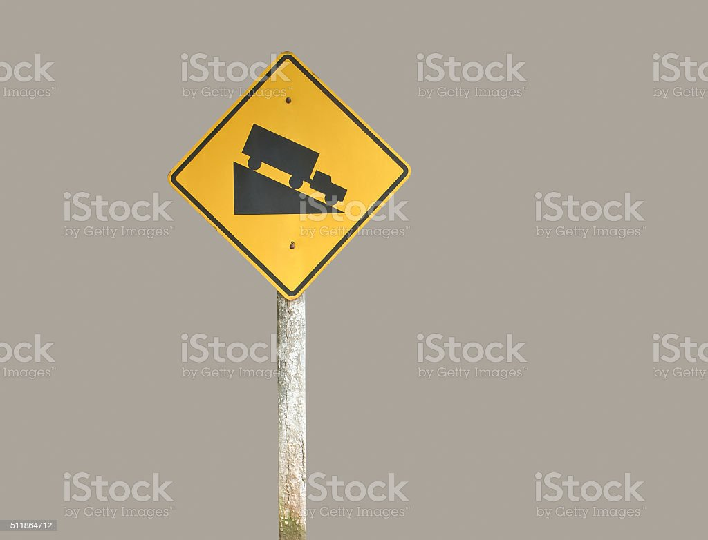 Road sign warning downhill use low gear isolated with clipping path.