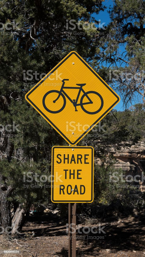 Road sign which reads 'Share the road' at the Grand Canyon National Park, South Rim, United States stock photo