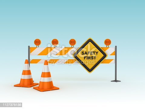 SAFETY FIRST Road Sign with Barrier and Cones - Blue Background - 3D Rendering