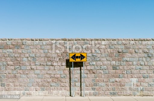 186103814istockphoto Road sign with double arrows 177811330