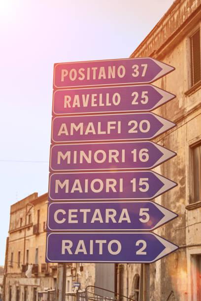 road sign with tourist cities on amalfi coast - cartello stradale italia km foto e immagini stock