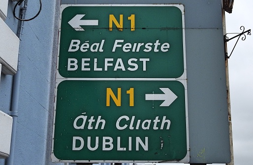 26th June 2020, Drogheda, County Louth, Ireland. Belfast, Dublin and Drogheda Town Centre directional road signs in English (and translated directly into the Irish language) in Drogheda town centre.