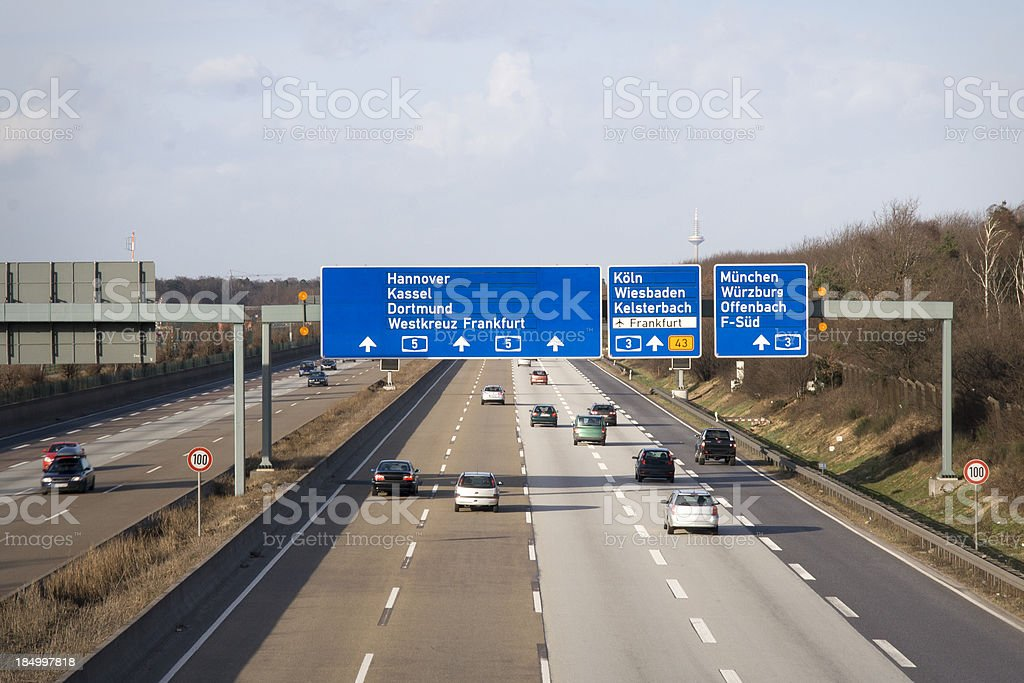 Road signs and traffic on german Autobahn A5 stock photo
