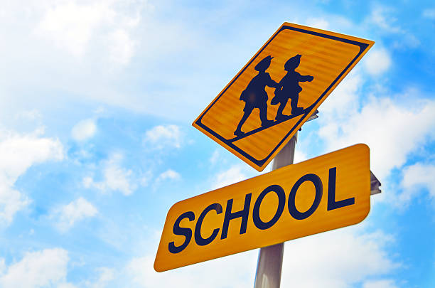 road signs in japan : warning signs, children crossing - school building stock photos and pictures