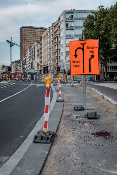 Road signs in support of massive roadworks in center of Antwerp Road signs in support of massive roadworks in center of Antwerp, Thursday 8 June 2017, Antwerp, Belgium. werken stock pictures, royalty-free photos & images