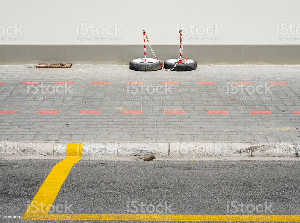 road signs on the sidewalk in a geometrical composition stock photo
