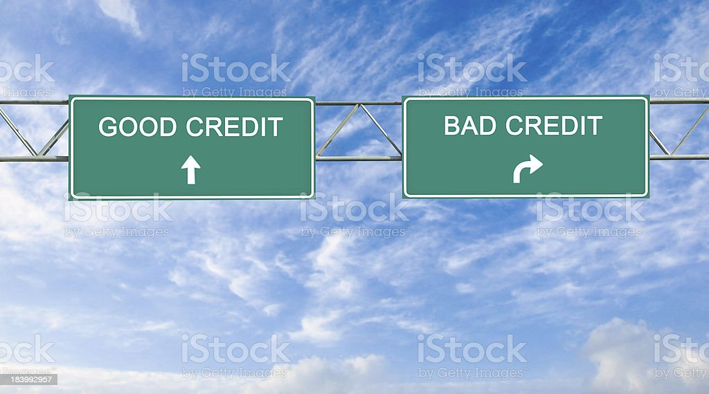 Road signs to good and bad credit stock photo