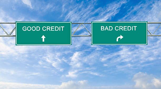 Cтоковое фото Дорожные знаки на хороший и плохой кредитной