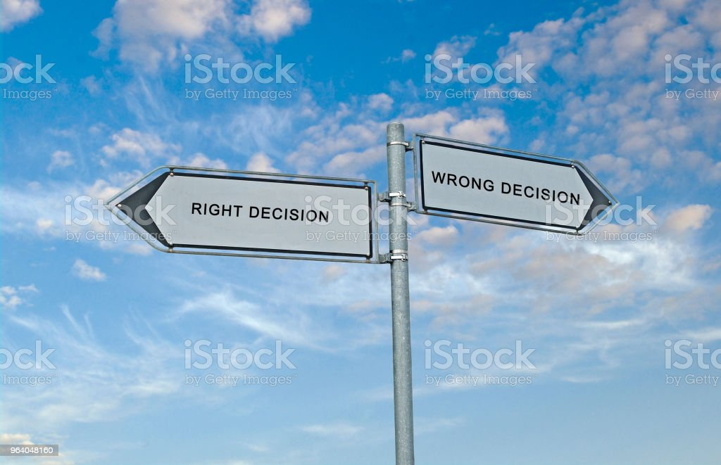 Road signs to right and wrong decisions - Royalty-free Blue Stock Photo