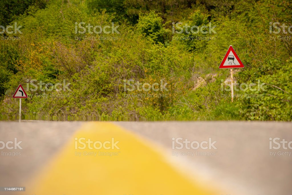 road signs warning drivers in jungle