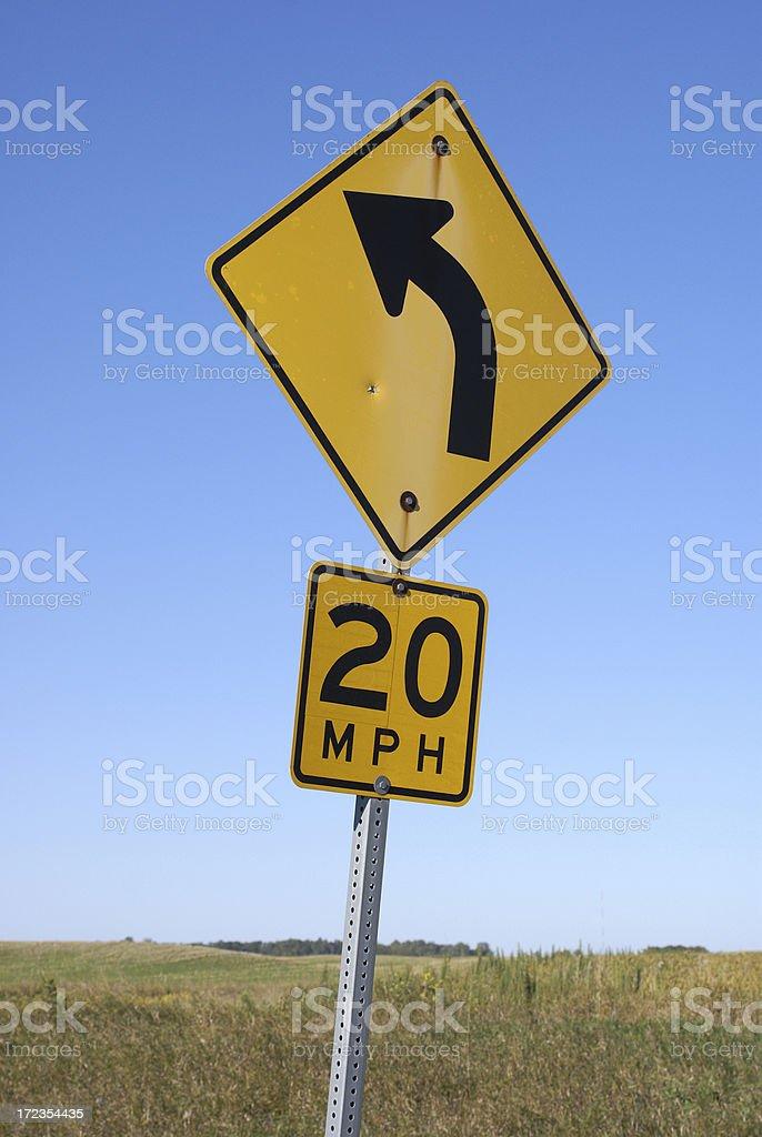 Señalizaciones: curva y 20 millas/hora foto de stock libre de derechos