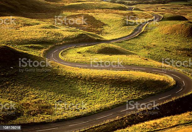 Road Snaking Through Landscape Stock Photo - Download Image Now