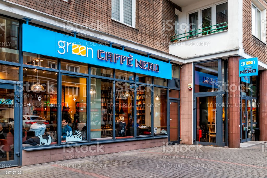 Road Street And Green Cafe Caffe Nero Restaurant With People Sitting Inside Eating In Warszawa Stock Photo Download Image Now Istock