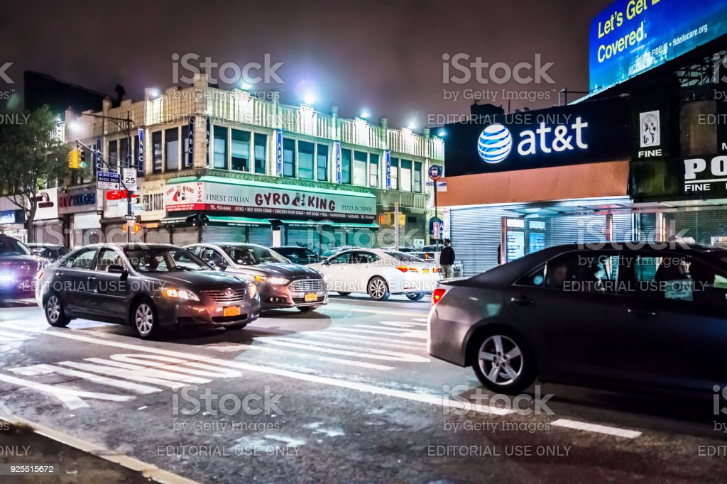 Road street in Fordham Heights center with cars traffic, New York City, NYC in evening night, gyro king food, att sign stock photo