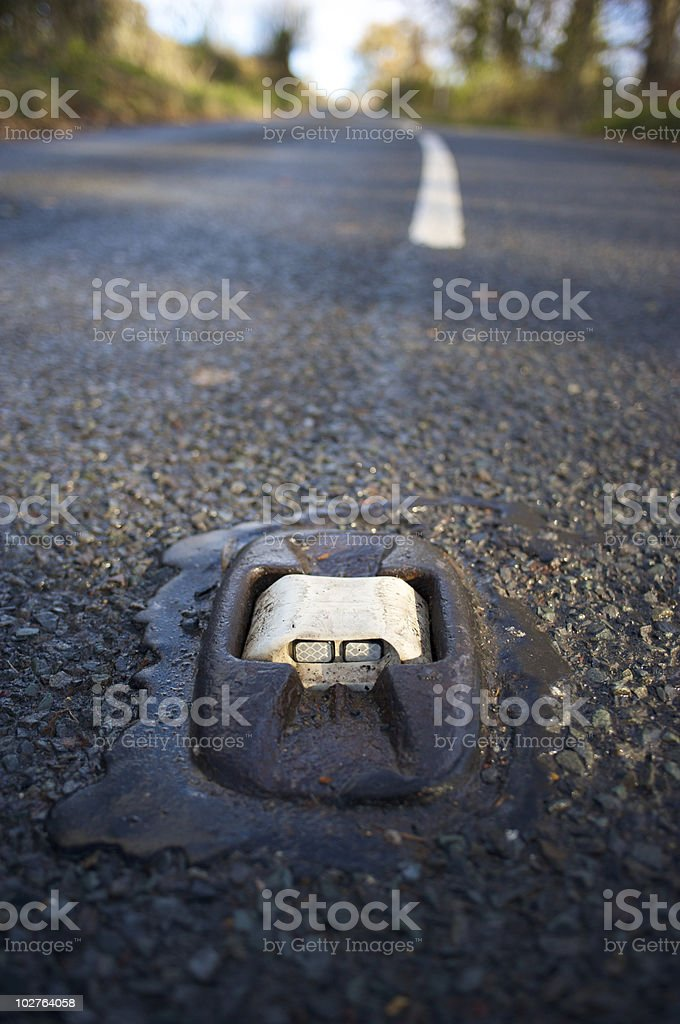 Road stud reflective safety marker stock photo