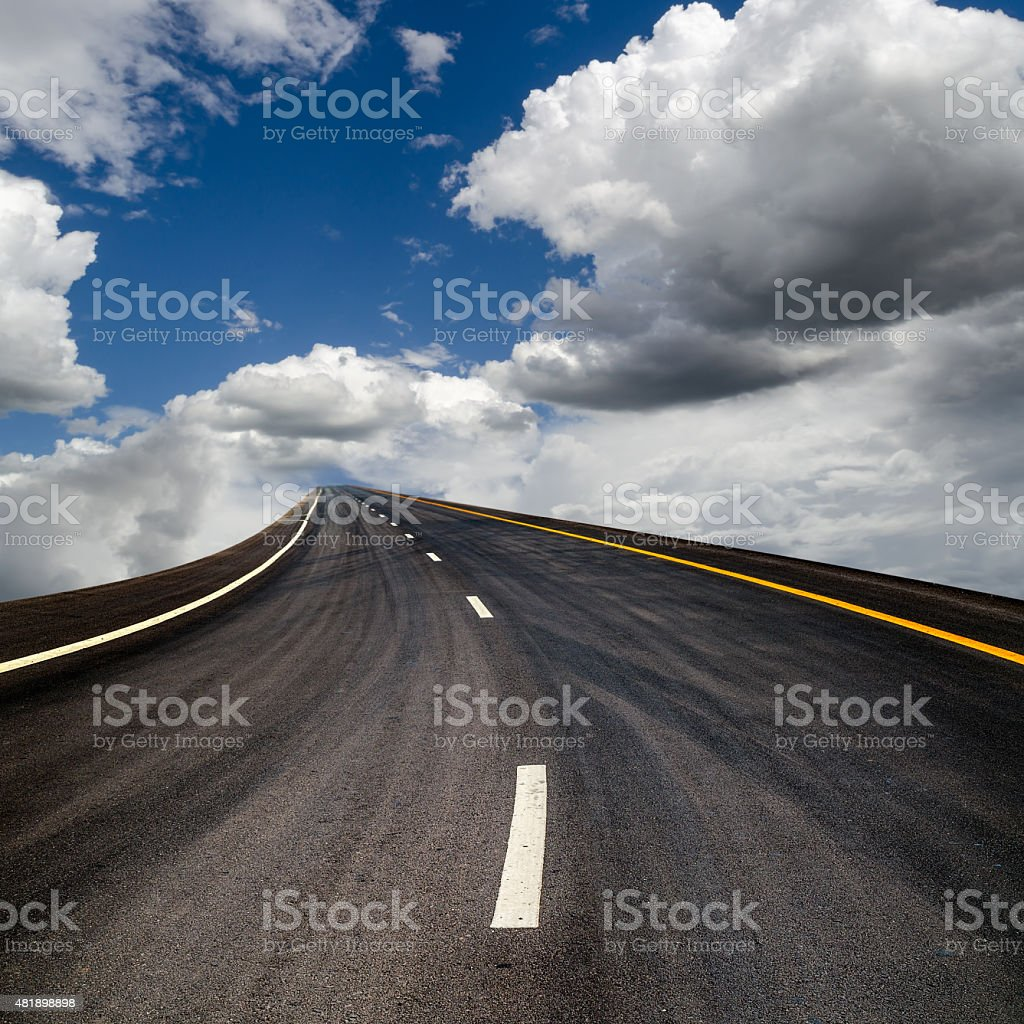 Road suspended in the sky over the clouds stock photo