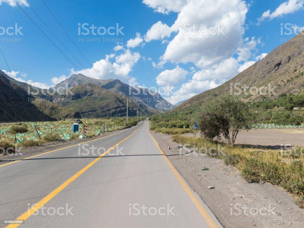 Road that runs through the Cajon del Maipo in the province of Chile, Chile stock photo