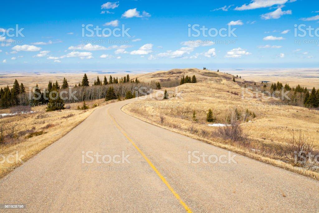 A road though Cypress Hills Interprovincial Park, Alberta, Canada stock photo