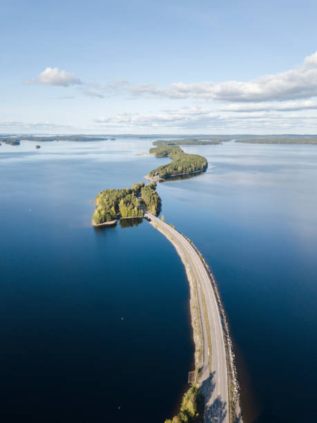 Road through a lake in Finland stock photo