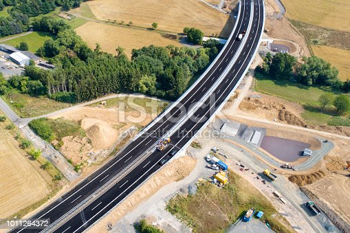 Road through agricultural area, construction site, aerial view