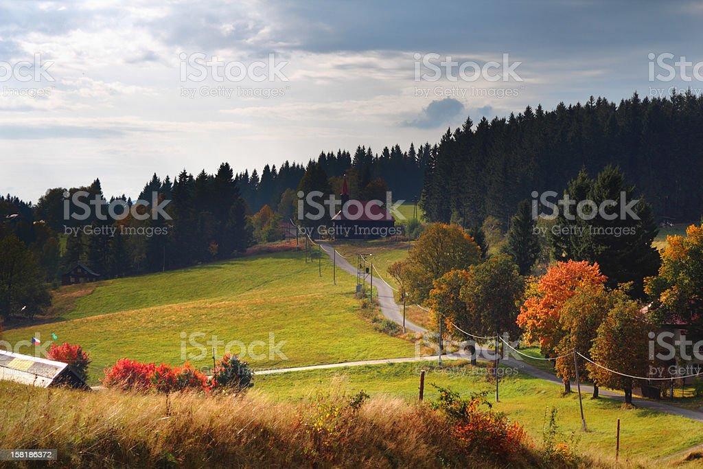 Road through autumn mountain landscape stock photo